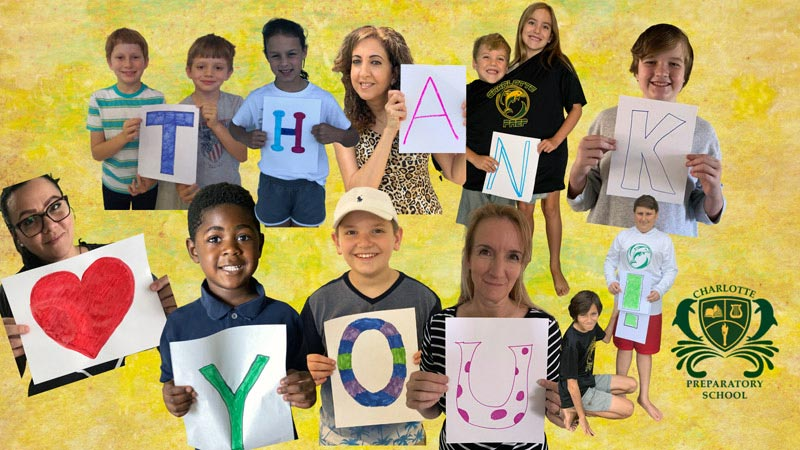 Charlotte Preparatory School Staff and Students Hold up Signs to Spell Thank You